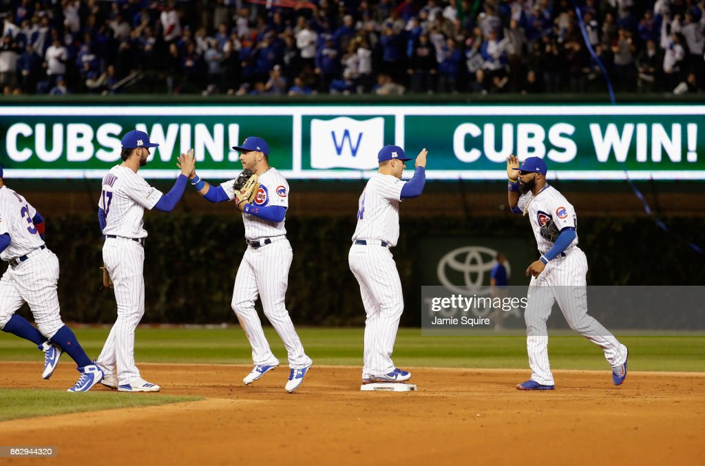 The Chicago Cubs celebrate after beating the Los Angeles Dodgers 3-2 in game four of the National League Championship Series at Wrigley Field on October 18, 2017 in Chicago, Illinois.