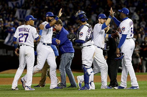 The Chicago Cubs celebrate after beating the San Francisco...