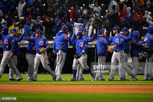 The Chicago Cubs celebrate after defeating the Cleveland Indians 51 in Game Two of the 2016 World Series at Progressive Field on October 26 2016 in...