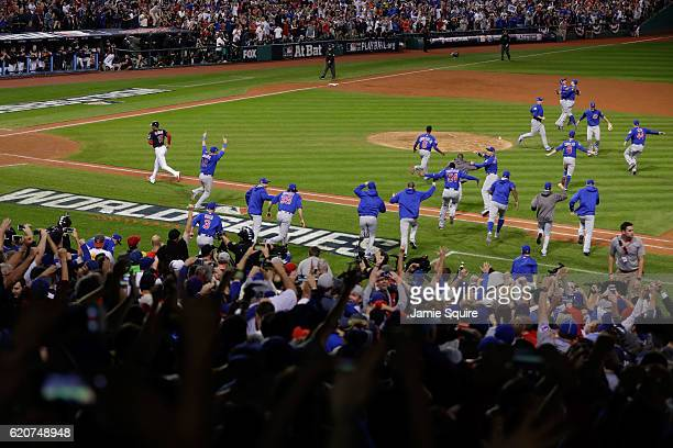 The Chicago Cubs celebrate after defeating the Cleveland Indians 8-7 in Game Seven of the 2016 World Series at Progressive Field on November 2, 2016...