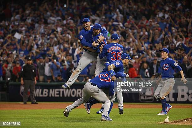The Chicago Cubs celebrate after defeating the Cleveland Indians Nov 3 2016 in Game 7 to win the World Series 87 at Progressive Field in Cleveland...
