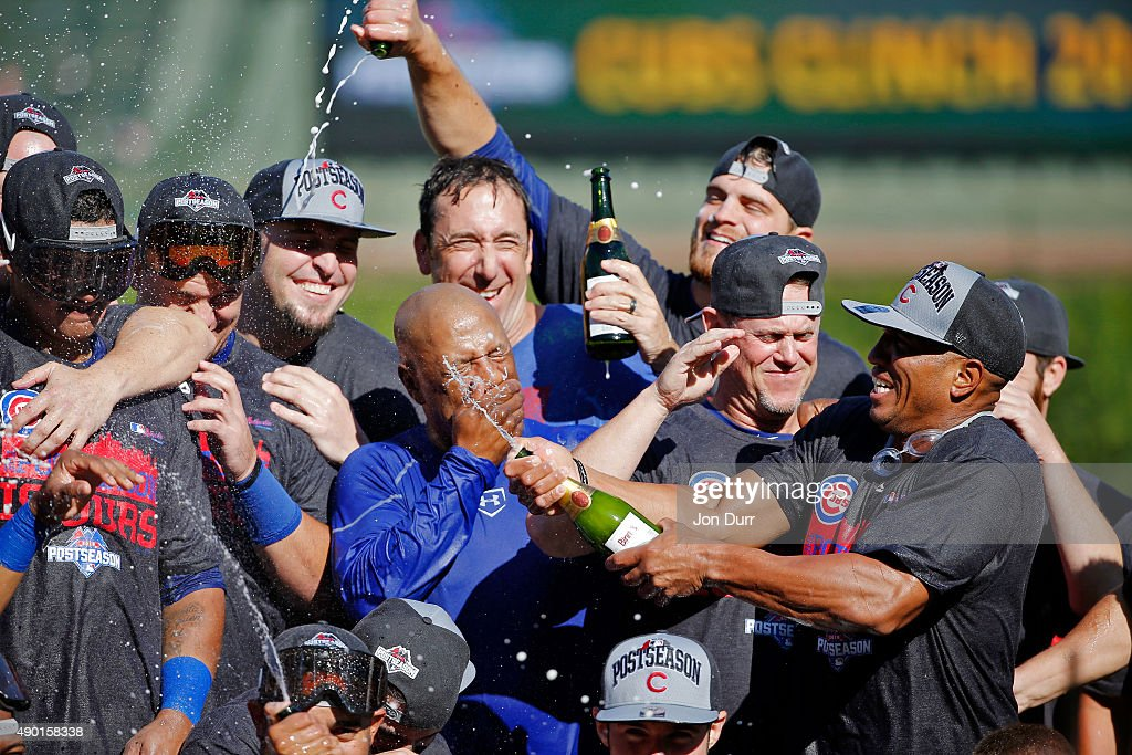 The Chicago Cubs celebrate clinching their Wildcard position after their game against the Pittsburgh Pirates at Wrigley Field on September 26, 2015 in Chicago, Illinois.