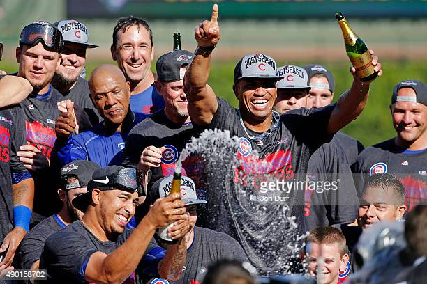 The Chicago Cubs celebrate clinching their Wildcard position after their game against the Pittsburgh Pirates at Wrigley Field on September 26, 2015...