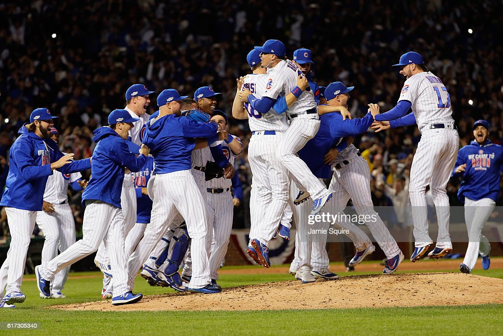 The Chicago Cubs celebrate defeating the Los Angeles Dodgers 5-0 in game six of the National League Championship Series to advance to the World Series against the Cleveland Indians at Wrigley Field on October 22, 2016 in Chicago, Illinois.