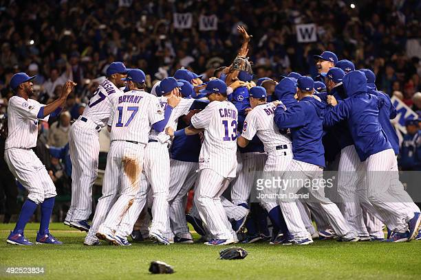 The Chicago Cubs celebrate defeating the St Louis Cardinals 64 in game four of the National League Division Series at Wrigley Field on October 13...