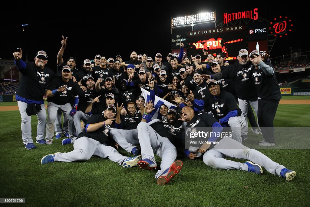 The Chicago Cubs celebrate during a team photo after the final out of Game 5 of the National League Divisional Series at Nationals Park on October 13, 2017 in Washington, DC. The Cubs won the game 9-8 and will advance to the National League Championship Series against the Los Angeles Dodgers.