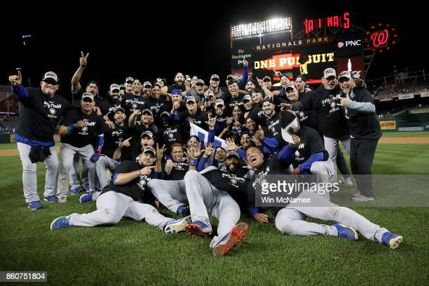 The Chicago Cubs celebrate during a team photo after the final out of Game 5 of the National League Divisional Series at Nationals Park on October 13...