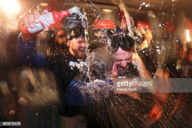 The Chicago Cubs celebrate in the locker room after defeating the Washington Nationals 98 in game five of the National League Division Series at...