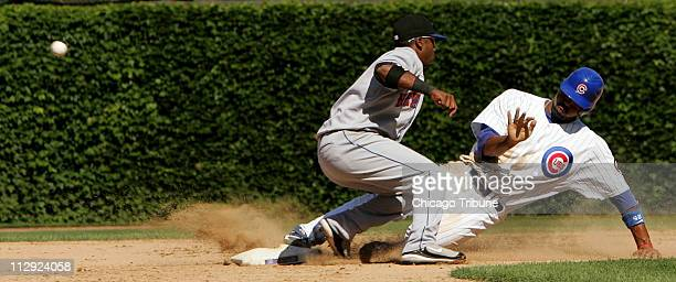 The Chicago Cubs' Derrek Lee steals second base in the eighth inning against the New York Mets and would go to third on the bad throw from catcher...