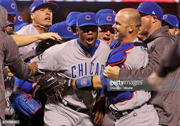 The Chicago Cubs mob Aroldis Chapman middle as they celebrate a 65 seriesclinching win against the San Francisco Giants in Game 4 of the National...