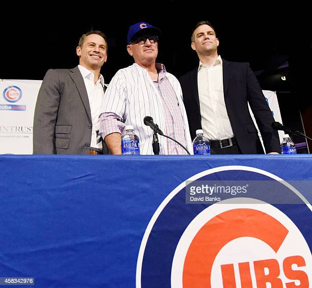 The Chicago Cubs new manager Joe Maddon Chicago Cubs general manager Jed Hoyer and President Theo Epstein pose during a press conference at Wrigley...