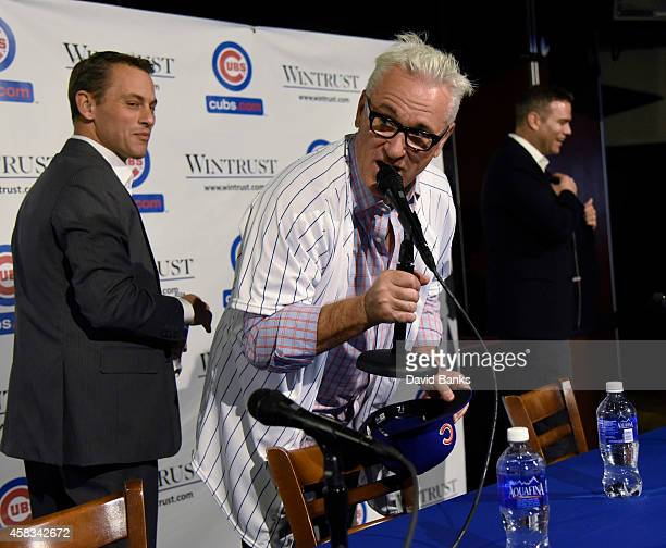 The Chicago Cubs new manager Joe Maddon makes a statement as Chicago Cubs President Theo Epstein and general manager Jed Hoyer look on after a press...