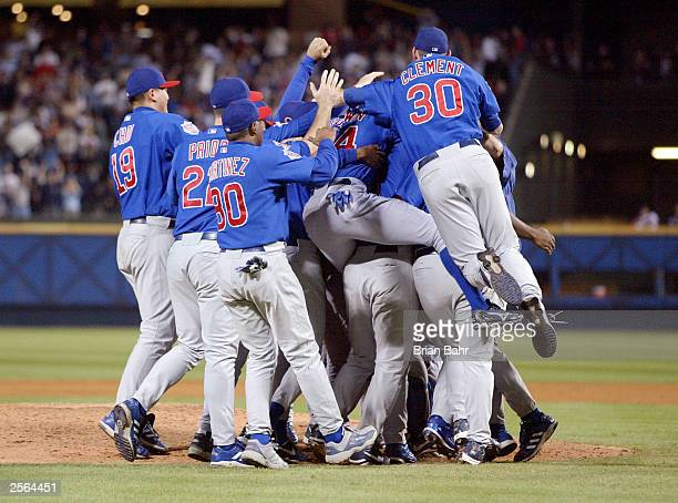 The Chicago Cubs pile up around the mound after defeating the Atlanta Braves in game five of their National League Division Series October 5 2003 at...