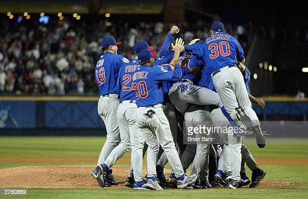 The Chicago Cubs pile up around the mound after the victory over the Atlanta Braves in game five of their National League Division Series on October...