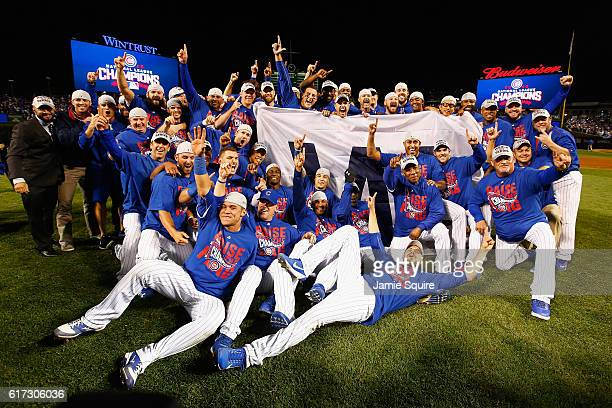 The Chicago Cubs pose after defeating the Los Angeles Dodgers 50 in game six of the National League Championship Series to advance to the World...