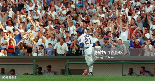 The Chicago Cubs' Sammy Sosa watches as his 62nd home run of the season sails over the fence against the Milwaukee Brewers at Wrigley Field in...