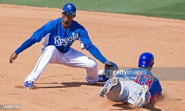 The Chicago Cubs' Starlin Castro steals second base before the throw reaches Kansas City Royals shortstop Alcides Escobar in the fifth inning in...