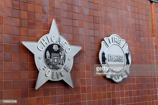 The Chicago Police and Chicago Fire Department badges are displayed on front of the City Of Chicago Public Safety Headquarters in Chicago Illinois on...