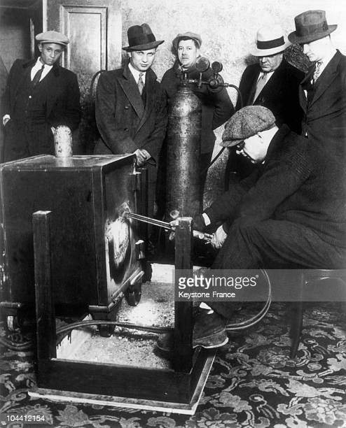 The Chicago police pictured opening the safe in Al CAPONE's home in 1931 After the arrest of the local gang's leader the courts and the IRS wanted to...