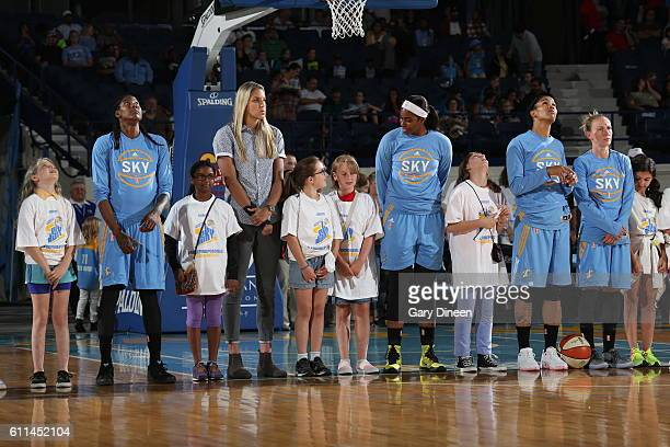 The Chicago Sky stand for the national anthem before the game against the New York Liberty on September 16 2016 at Allstate Arena in Chicago Illinois...