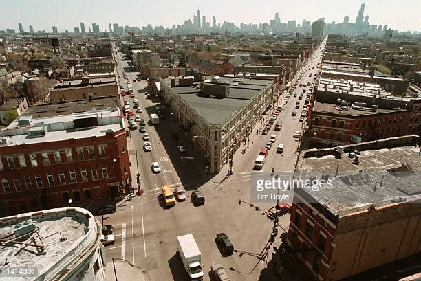 The Chicago skyline looms in the background in this view from the North West Tower in Chicago''s Wicker Park neighborhood April 12 2000 The three...