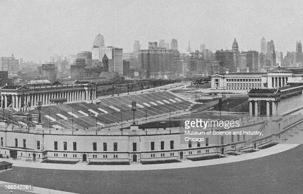 The Chicago skyline stands in the background of Soldier Field in Grant Park at the Century of Progress International Exposition The Century of...