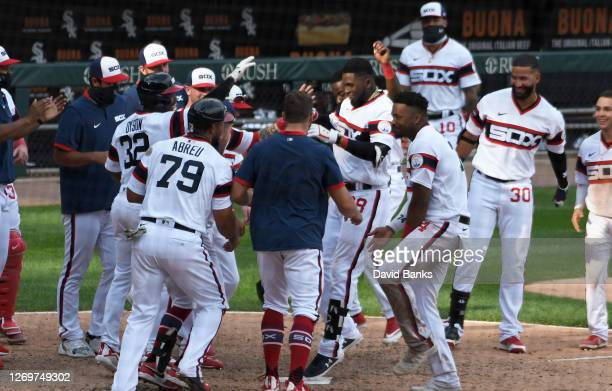 The Chicago White Sox celebrate Luis Robert walk off three run home run against the Kansas City Royals during the tenth inning at Guaranteed Rate...