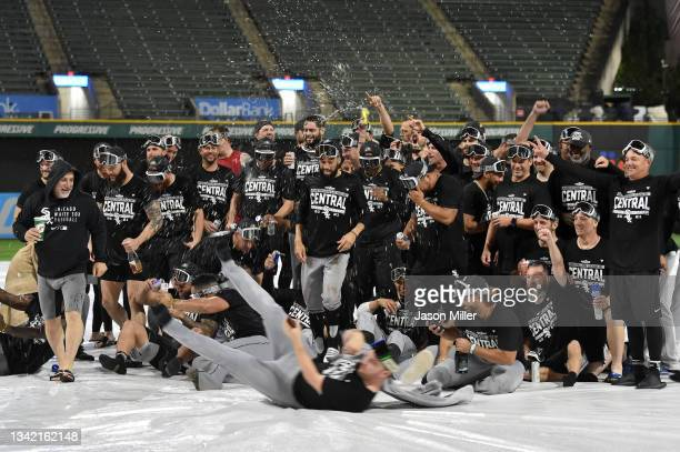 The Chicago White Sox celebrate on the field after clinging the American League Central title after game two of a double header against the Cleveland...
