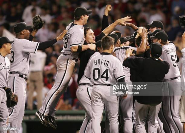The Chicago White Sox celebrate on the field after winning Game Three of the American League Division Series against the Boston Red Sox at Fenway...