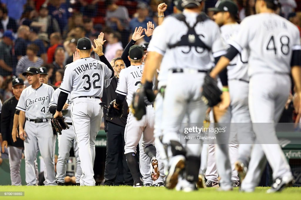 The Chicago White Sox high five each other after a victory over the Boston Red Sox at Fenway Park on June 08, 2018 in Boston, Massachusetts.