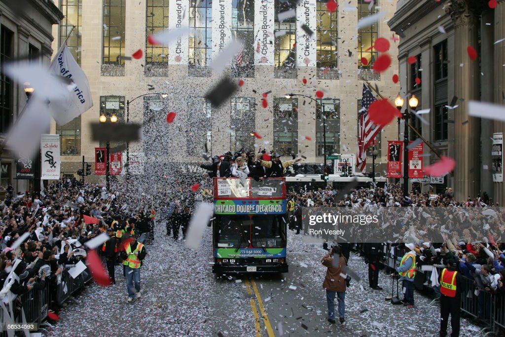 The Chicago White Sox ride in a motorcade through Chicago neighborhoods and down LaSalle street in a ticker tape parade after winning the 2005 World Series, sweeping the Houston Astros in 4 games on October 28, 2005 in Chicago, Illinois. The City of Chicago estimated that 1.75 million people lined the parade route.