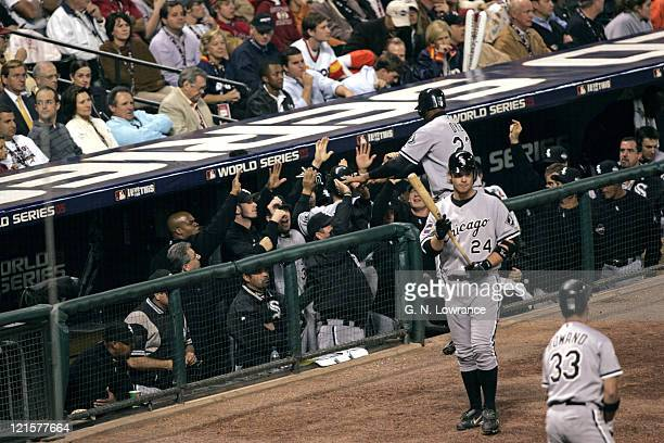 The Chicago White Soxs congratulate Tadahito Iguchi and Jermaine Dye during action in game 3 of the World Series between the Chicago White Sox and...