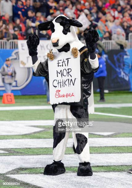 The Chickfila Cow dances in the end zone prior to the start of the 2018 Peach Bowl on January 1 2018 at MercedesBenz Stadium in Atlanta GA The...