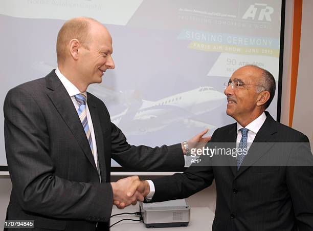 The chief executive officer of the European turboprop manufacturer ATR, Filippo Bagnato , shakes hands on June 18, 2013 with the chairman of the...