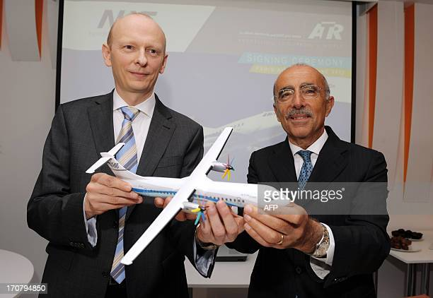 The chief executive officer of the European turboprop manufacturer ATR, Filippo Bagnato , poses on June 18, 2013 with the chairman of the Danish...