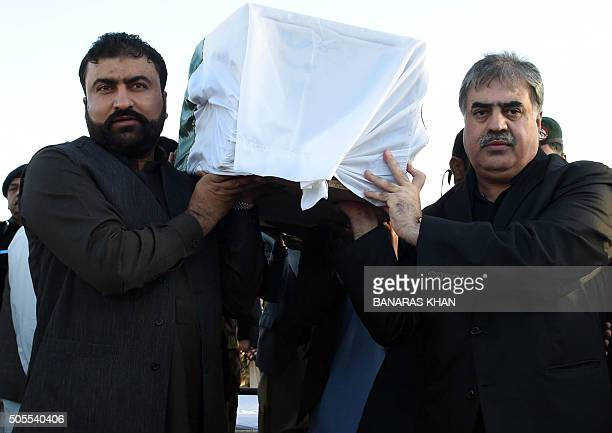 The Chief Minister of Balochistan Nawab Sanaullah Zehri and provincial home minister Sarfraz Bugti carry the coffins of a paramilitary soldier who...