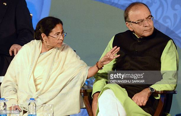 The Chief Minister of the Indian state of West Bengal Mamata Banerjee gestures as Indian Union Finance Minister Arun Jaitley looks on during the...