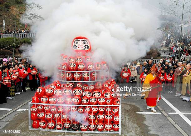 The chief monk sets fire on the daruma dolls during the memorial ceremony at Dairyuji Temple on January 18 2009 in Gifu Japan The doll modelled after...