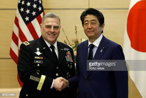 The chief of staff of the US Army General Mark Milley shakes hands with Japan's Prime Minister Shinzo Abe during their meeting at Abe's official...