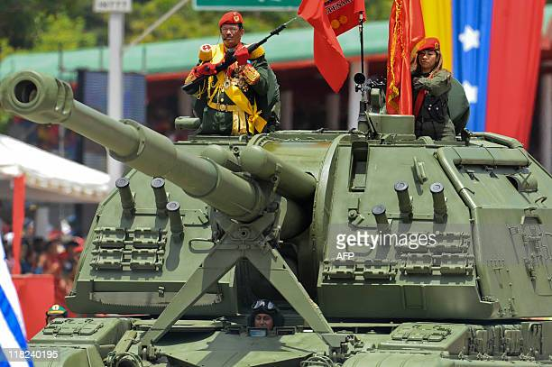The chief of the parade army Brigadier Carlos Alcala Cordones stands on the turret of a Russianmade Venezuelan army 2S19 MstaS 152mm...