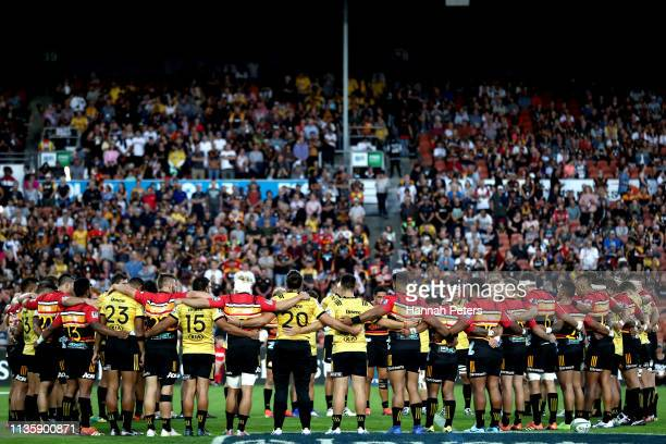The Chiefs and Hurricanes gather together to remember the victims of the Christchurch shooting ahead of the round five Super Rugby match between the...