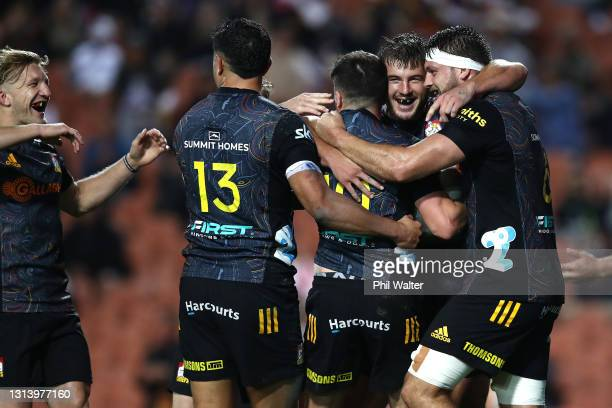 The Chiefs celebrate a try to Bryn Gatland during the round nine Super Rugby Aotearoa match between the Chiefs and the Hurricanes at FMG Stadium...