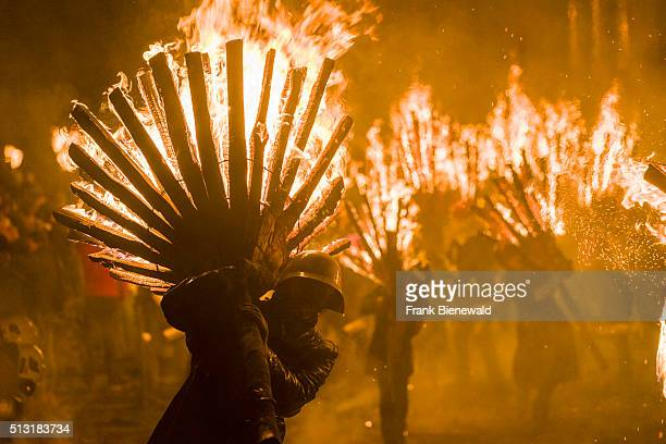 The Chienbäse is part of the Basler Fasnacht carriers loaded with burning wood are pulled and carried through town watched by the spectators and the...