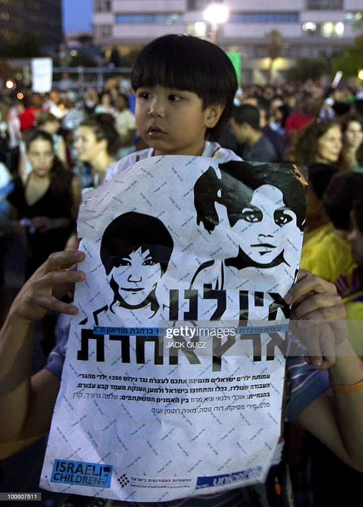 The child of immigrants holds a placard against deportation during a protest calling on the Israeli government to allow illegal immigrants to stay in Israel, in Tel Aviv on May 25, 2010.