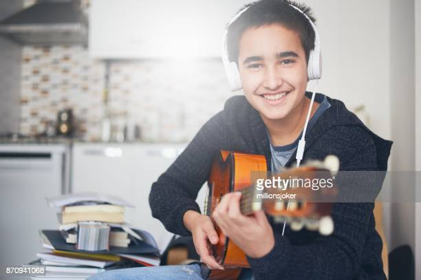 The child Who is plays The guitar on the kitchen