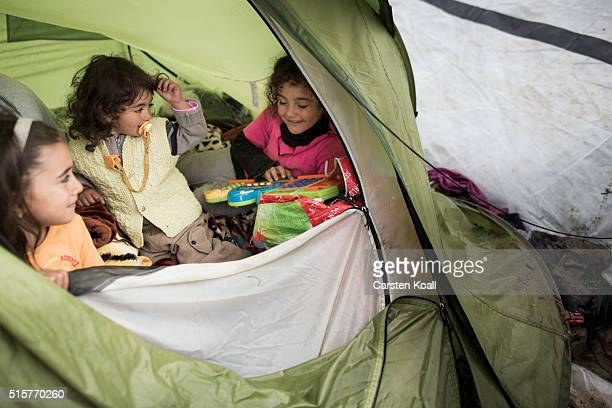 The childen of Omar Mohamed Firras play in a tent at the Idomeni refugee camp on March 15 2016 in Idomeni Greece The decision by Macedonia to close...