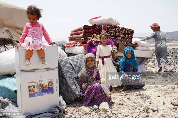 The children of Hadi Ahmed, who was forced to flee his home in the government's last northern stronghold which is under intense pressure from Huthi...