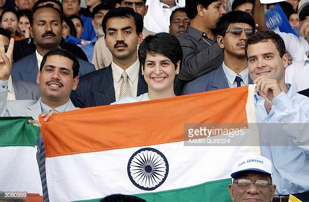 The children of Indian opposition leader Sonia Gandhi Priyanka Gandhi Rahul Gandhi and Priyanka's husband Robert Vadra hold an Indian flag as they...