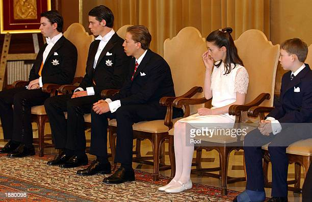 The children of Luxembourg's Grand Duke Henri and Grand Duchess Maria Teresa, Guillaume, Felix, Louis, Alexandra and Sebastien sit during a meeting...