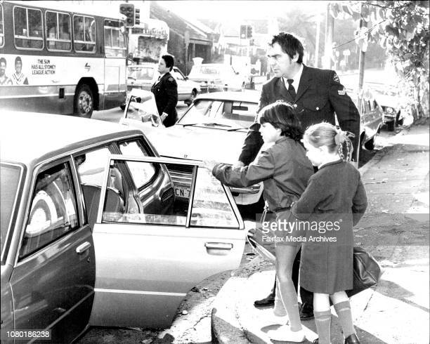 The children of murdered judge Mr. Justice Opas are taken by a police office to a friends car, they were dressed ready for school.Children Joshua, 6...